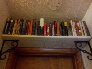 bookshelf over bedroom door